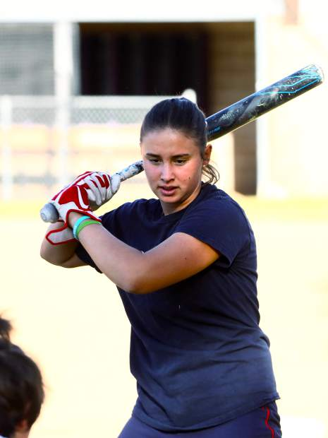Basalt High School senior Zoe Vozick works on her swing as the softball team practices on Wednesday, Oct. 16, 2019, on the BHS field. (Photo by Austin Colbert/The Aspen Times)