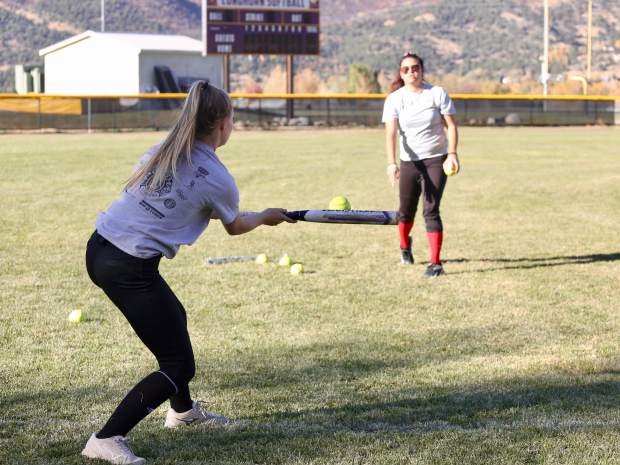 The Basalt High School softball team practices on Wednesday, Oct. 16, 2019, on the BHS field. (Photo by Austin Colbert/The Aspen Times)