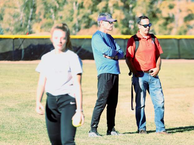 Basalt High School athletic director Jason Santo, right in red, talks with BHS softball coach David Miller during team practice on Wednesday, Oct. 16, 2019, on the BHS field. (Photo by Austin Colbert/The Aspen Times)