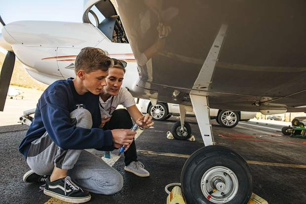 Director of Aviation Kate Short, right, shows student Kaden Ramsey, 14, how to check the fuel during a pre-flight safety check at the Aspen/Pitkin County Airport on Thursday, October 3, 2019. (Kelsey Brunner/The Aspen Times)