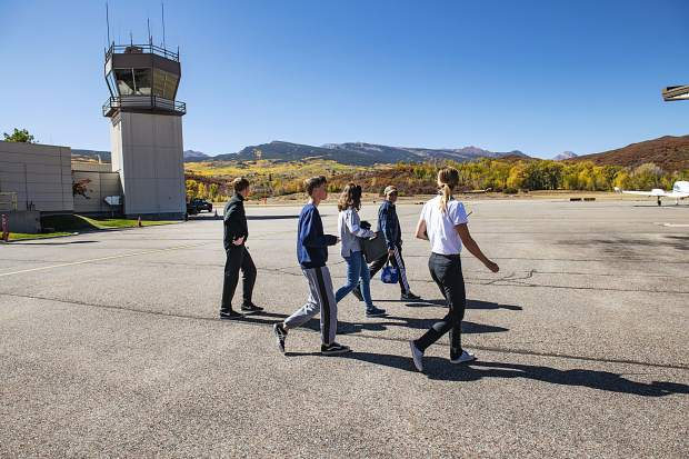 Aspen High School students of the aviation program walk onto the Aspen/Pitkin County Airport tarmac on Thursday, October 3, 2019. (Kelsey Brunner/The Aspen Times)