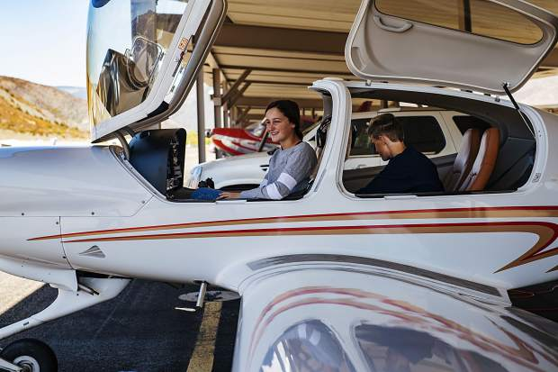 Bennett Jones, 14, left, and Kaden Ramsey, 14, sit in the plane they will receive a free flight lesson in during an aviation program through Aspen High School at the Aspen/Pitkin County Airport on Thursday, October 3, 2019. (Kelsey Brunner/The Aspen Times)
