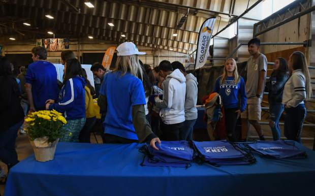 Students enter the indoor arena at the Garfield County Fairgrounds for Tuesday's GlenX Career Expo.