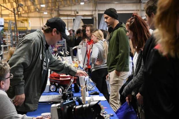 Colorado Mountain College professors speak to students during Tuesday's GlenX Career Fair at the Garfield County Fairgrounds in Rifle.
