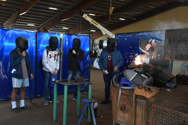 Students watch during a welding demonstration at the GlenX Career Expo at the Garfield County Fairgrounds on Tuesday.