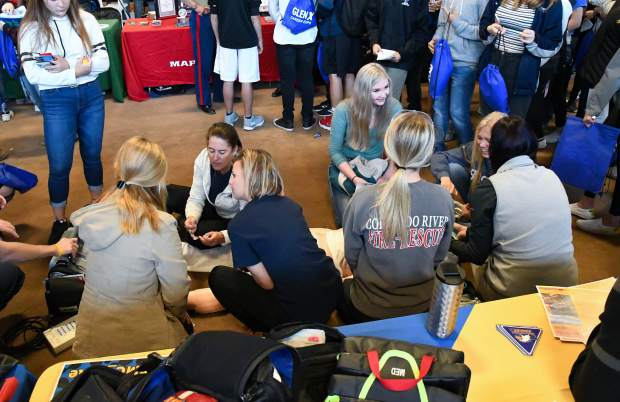Colorado Mountain College professors speak to students about the nursing program during the 2019 GlenX Career Fair.