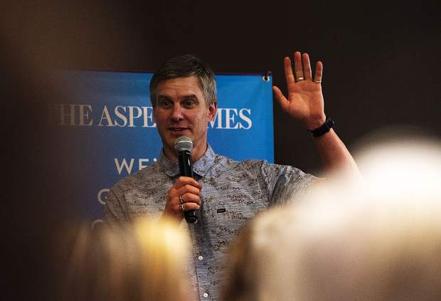 Keynote Speaker Mike Libecki addresses before beginning his talk for The Longevity Project in the Mountain Chalet on Tuesday, October 1, 2019. Libecki is a National Geographic Explorer and showed some of his expeditions through films and photographs. (Kelsey Brunner/The Aspen Times)