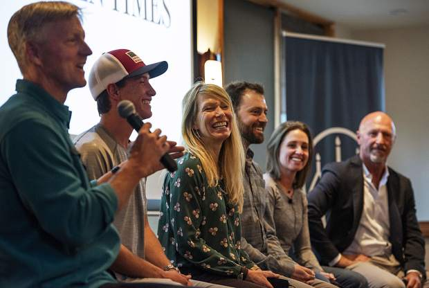 The Longevity Project panel moderator Penn Newhard addresses the panelists with one of his questions in the Mountain Chalet on Tuesday, October 1, 2019. (Kelsey Brunner/The Aspen Times)