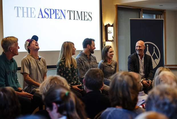 Panelists laugh while talking to an audience about their personal beliefs and how they live their lives in the mountains at the Mountain Chalet in Aspen on Tuesday, October 1, 2019. (Kelsey Brunner/The Aspen Times)