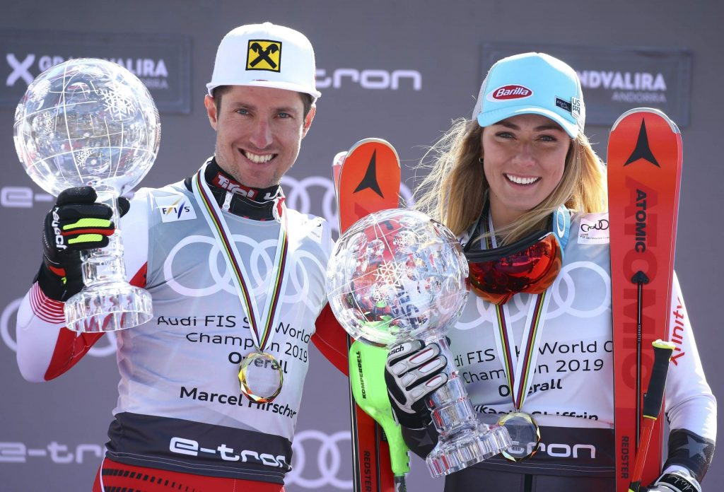 FILE - In this Sunday, March 17, 2019 file photo, Austria's Marcel Hirscher, left, and United States' Mikaela Shiffrin hold the World Cup overall trophies, at the alpine ski finals in Soldeu, Andorra. A new Alpine ski season starts this month, Oct. 2019, with Mikaela Shiffrin the expected superstar and China poised to be a surprise success. Shiffrin is the sport's most bankable star after Lindsey Vonn, Marcel Hirscher, and Aksel Lund Svindal all retired. (AP Photo/Alessandro Trovati, File)