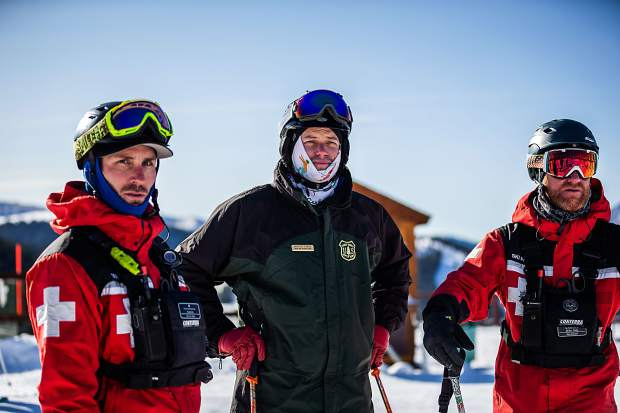 Snow Ranger Marcus Dreux (center) is on duty with members of the Keystone ski patrol on Saturday, Oct. 12.
