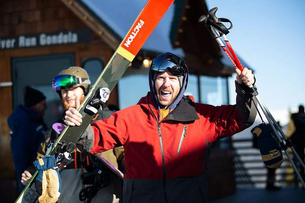 Opening day is cause for celebration as skiers and snowboarders line up at the River Run Gondola at Keystone on Saturday, Oct. 12.