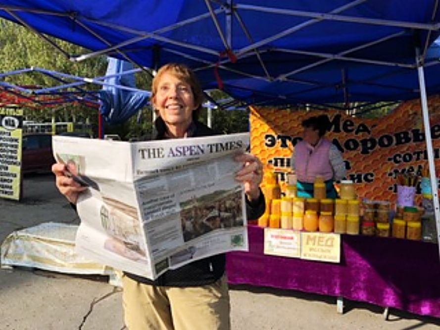 Reader Kathryn Koch refers to the Aspen Times while shopping at a honey market in Bishkek, Kyrgyzstan.