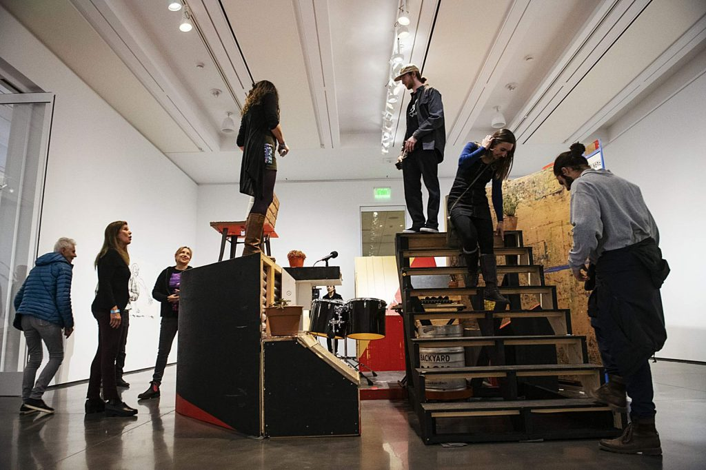 "People climb on a part of Abraham Cruzvillegas's interactive exhibition during the opening of ""Hi, how are you, Gonzo?"" in the Aspen Art Museum on Thursday, October 17, 2019. (Kelsey Brunner/The Aspen Times)"