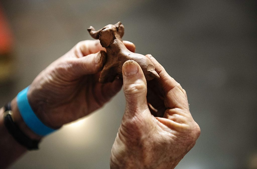 Annette Roberts-Gray forms a clay elephant with the material used in the Abraham Cruzvillegas exhibition at the Aspen Art Museum on Thursday, October 17, 2019. (Kelsey Brunner/The Aspen Times)