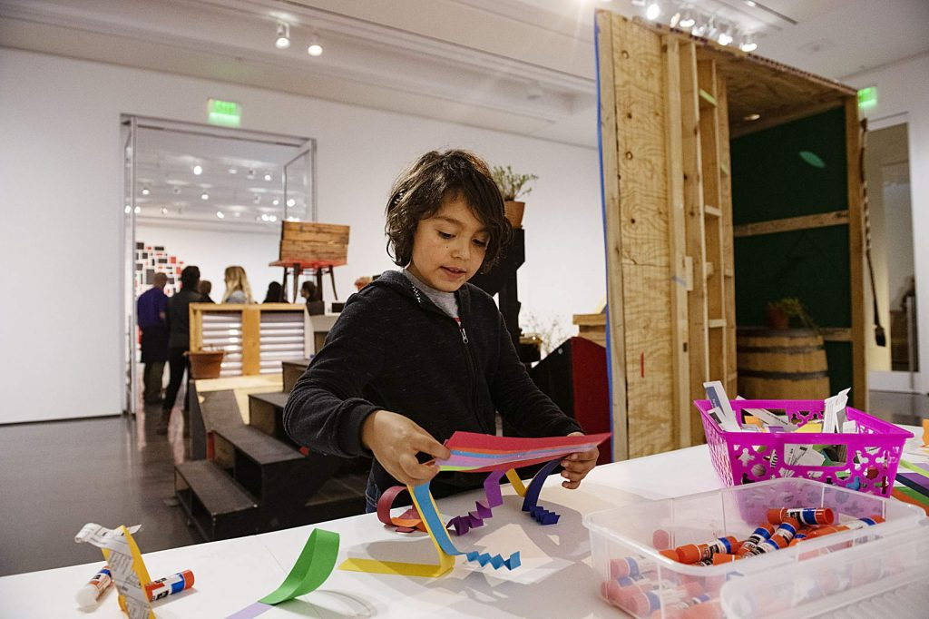 Sacha Beauregard, 7, creates a paper art piece during the opening of the Abraham Cruzvillegas exhibition at the Aspen Art Museum on Thursday, October 17, 2019. (Kelsey Brunner/The Aspen Times)
