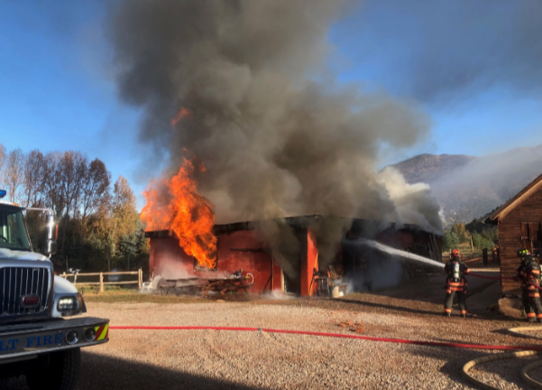 Crews work on a structure fire Monday at a farm near Basalt. There were no injuries reported and the building was totaled.