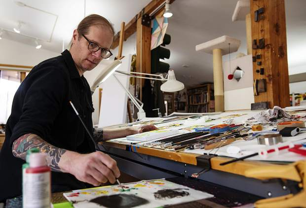 Robert Brinker finishes one of his small canvas paintings for his show at the Art Base in his studio on Wednesday, October 9, 2019. (Kelsey Brunner/The Aspen Times)
