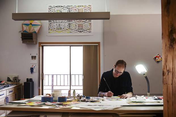 Artist Robert Brinker finishes one of his small canvas paintings for his upcoming show at the Art Base in his studio on Wednesday, October 9, 2019. (Kelsey Brunner/The Aspen Times)