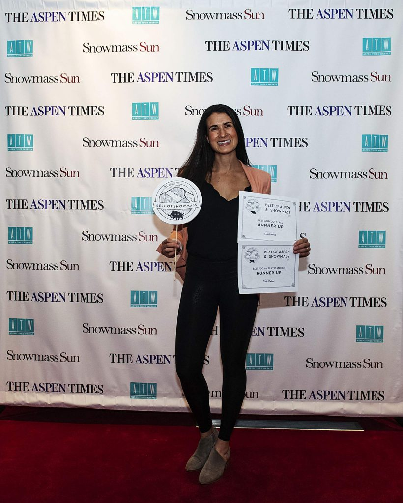 Tonic Method owner Madeleine Hasulak poses with her awards forBest Workout Class and Best Yoga/Pilates Studio during the Best of Aspen and Best of Snowmass Party at The Wheeler on Wednesday, October 23, 2019. (Kelsey Brunner/The Aspen Times)