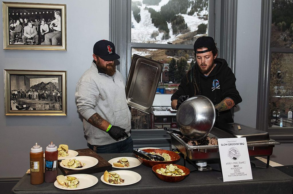 Slow Groovin' prepares pulled pork sandwiches for the attendees of the Best of Aspen and Best of Snowmass Party at The Wheeler on Wednesday, October 23, 2019. (Kelsey Brunner/The Aspen Times)