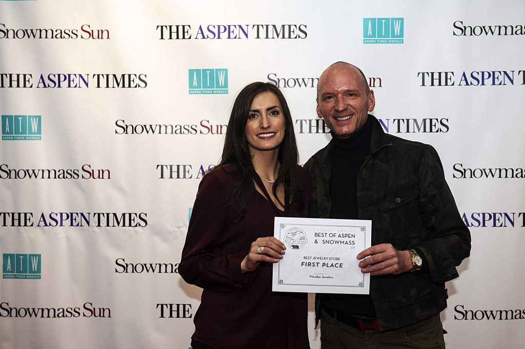 Lorena Rojas, left, and Stephan Huber hold up the award for Meridian Jewelers Best Jewelry Store during the Best of Aspen and Best of Snowmass Party at The Wheeler on Wednesday, October 23, 2019. (Kelsey Brunner/The Aspen Times)