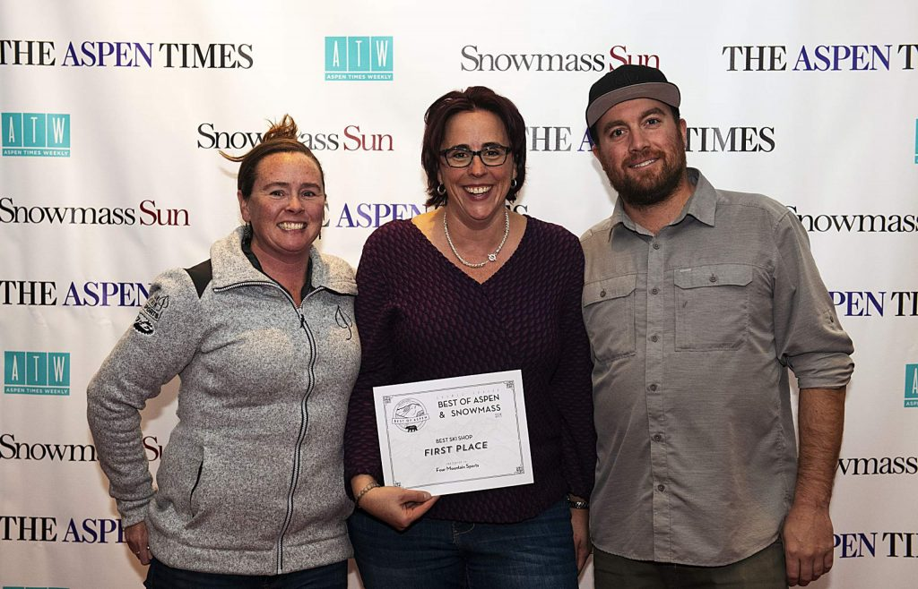 Representatives of Four Mountain Sports hold up awards for Best Ski Shop Aspen, Best Bike Shop Aspen & Snowmass during the Best of Aspen and Best of Snowmass Party at The Wheeler on Wednesday, October 23, 2019. (Kelsey Brunner/The Aspen Times)