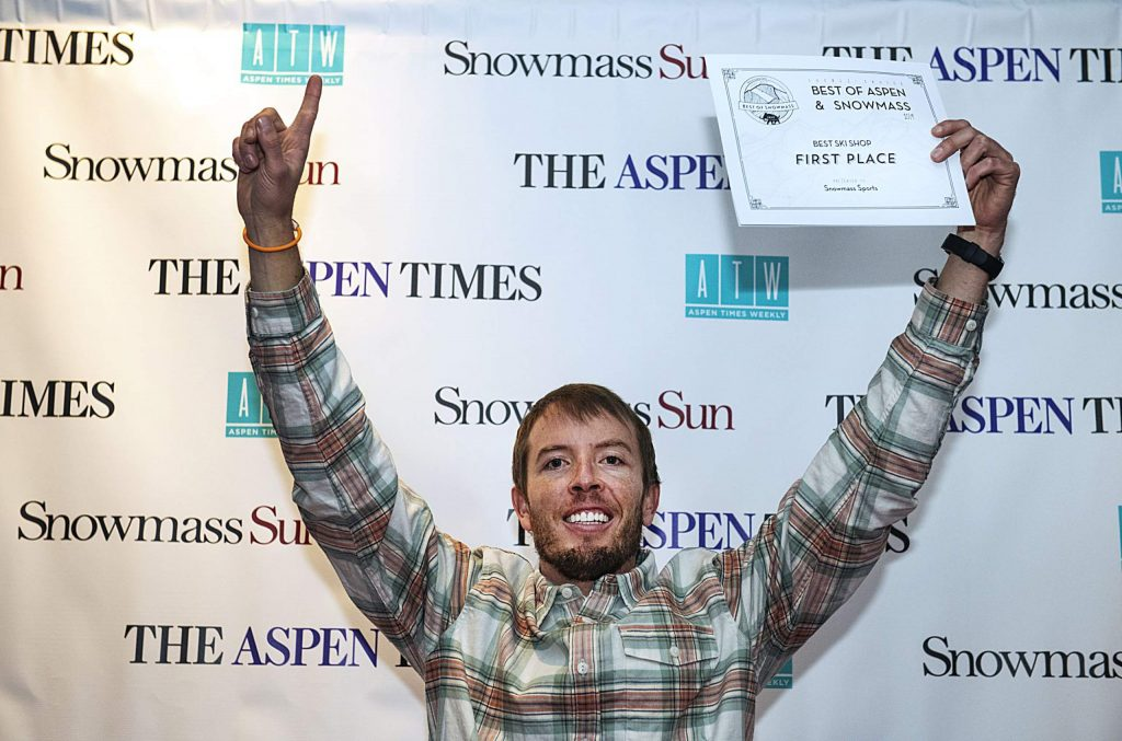Cameron Wenzel holds up his hands in victory for a picture with his award for the Best Ski Shop in Snowmass for Snowmass Sports during the Best of Aspen and Best of Snowmass Party at The Wheeler on Wednesday, October 23, 2019. (Kelsey Brunner/The Aspen Times)
