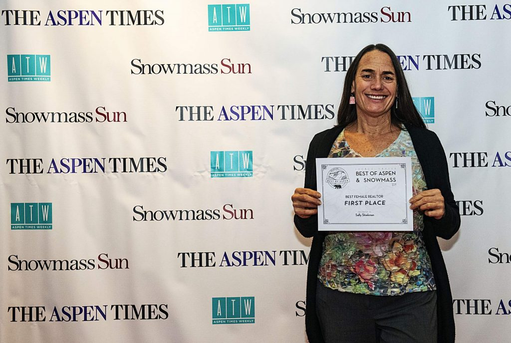 Aspen Snowmass Sotheby's Sally Shiekman holds up her award for Best Female Realtor during the Best of Aspen and Best of Snowmass Party at The Wheeler on Wednesday, October 23, 2019. (Kelsey Brunner/The Aspen Times)