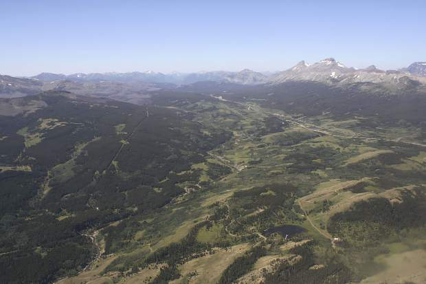 This June 16, 2015, aerial file photo, shows the Badger-Two Medicine area near the Blackfeet Indian Reservation and Glacier National Park, rear, in Montana. President Donald Trump's public lands steward, acting U.S. Bureau of Land Management Director William Perry Pendley, has recused himself from dealings with a company seeking to drill in the Badger-Two Medicine following criticism from U.S. Sen. Jon Tester and environmentalists.