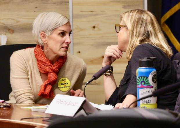 Patsy Kurkulis, left, talks with Bettina Slusar during the Aspen School District Board of Education candidate forum on Thursday, Oct. 17, 2019, at the Pitkin County building in Aspen. (Photo by Austin Colbert/The Aspen Times)