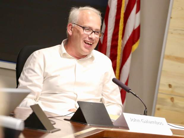 John Galambos laughs during the Aspen School District Board of Education candidate forum on Thursday, Oct. 17, 2019, at the Pitkin County building in Aspen. (Photo by Austin Colbert/The Aspen Times)
