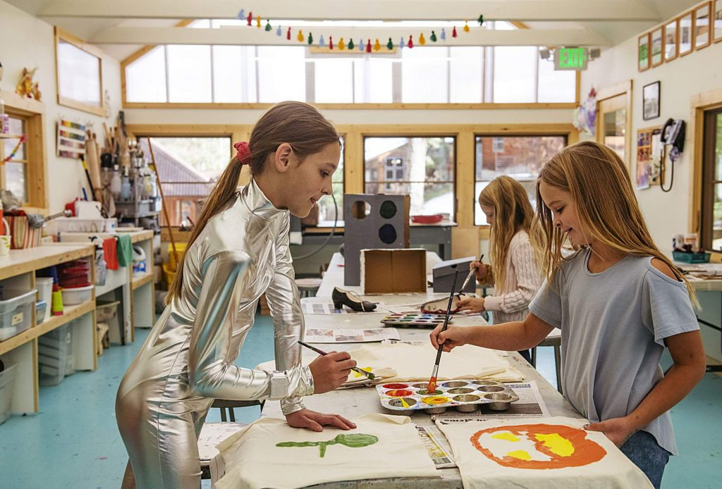 Annika Lundeen, 11, left, and Norah Glasgow, 9, paint canvas in the Children's Workshop in Snowmass on Tuesday, October 22, 2019. Lundeen is planning to dress as an alien for Halloween and Glasow will be a rainbow angel.