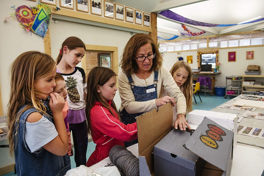 Anderson Ranch after school program facilitator Alison Viola, center right, helps with a rainbow robot costume in the Children's Workshop in Snowmass on Tuesday, October 22, 2019.