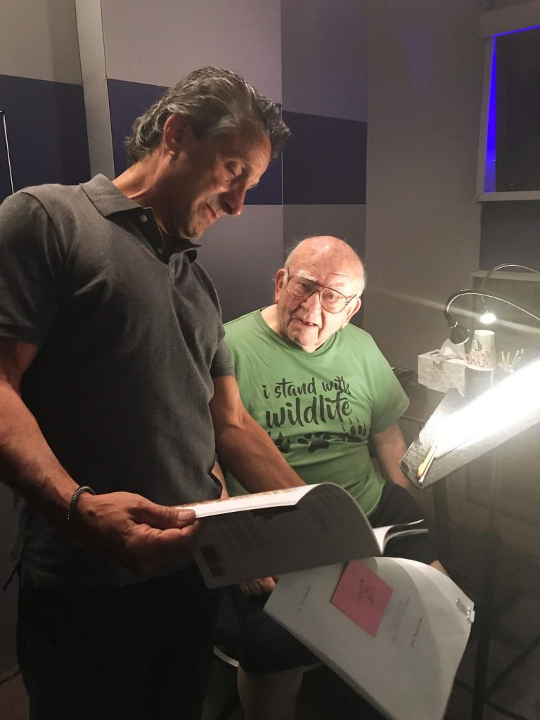 Bennett with actor Ed Asner on the set of