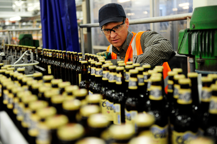 Denver, CO - December 11: Engineer Tom Lechlak watches Coors Banquet bottles move along the line during packaging at the Golden brewery on Wednesday, December 11, 2013. Coors Banquet, the brewer's original brand, is the only mass-market domestic beer whose sales are increasing as every other major beer is losing market share to fast-growing crafts and spirits.