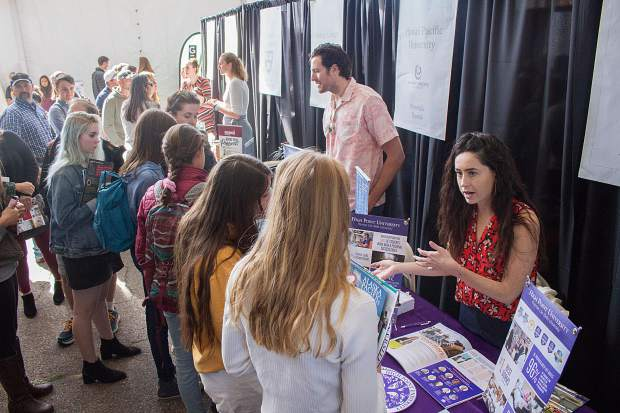 High school students talk with Brooke Cavallo, an admissions officer with High Point University in North Carolina, during the 15th annual Colorado Western Slope College Fair on Sunday, Oct. 6.