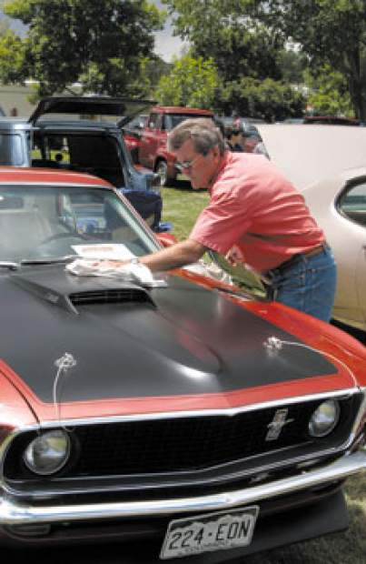 A participant in a past Valley Cruisers Car Show buffs the hood of his Mustang. The event returns this weekend, making the move from Carbondale's Sopris Park to Main Street. The show starts Friday evening and continues Saturday in downtown Carbondale (Valley Journal file)