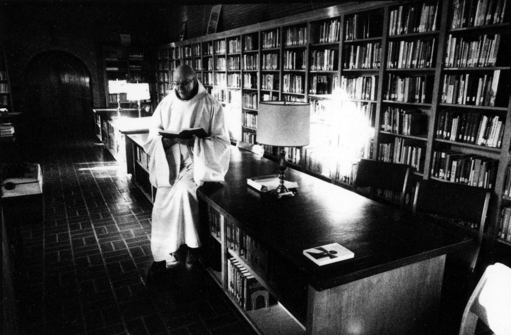 Thomas Keating photographed by Robert Chamberlain in the library at St. Benedict's Monastery during the 1980s.