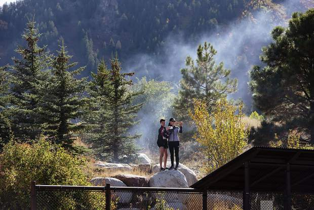 Cross Country fans take video of the start of the Varsity girls race during the Chris Severy Invitaional in Aspen on Saturday, October 5, 2019. (Kelsey Brunner/The Aspen Times)