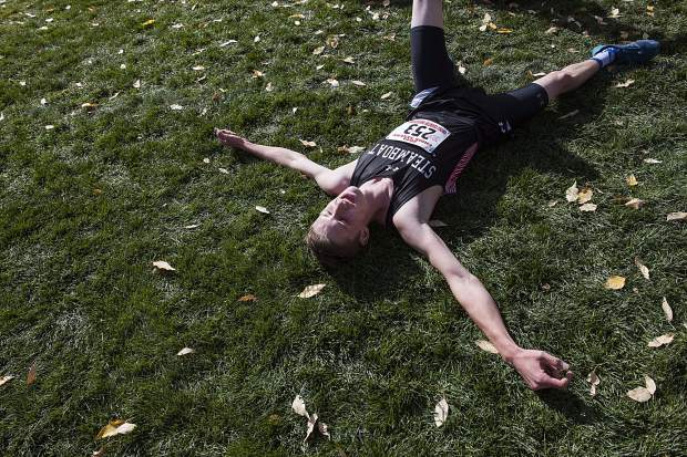 Steamboat Springs Varsity Cross Country runner Bowden Tumminello lays on the ground after crossing the finish line second at the 2019 Chris Severy Invitational in Aspen on Saturday, October 5, 2019. (Kelsey Brunner/The Aspen Times)