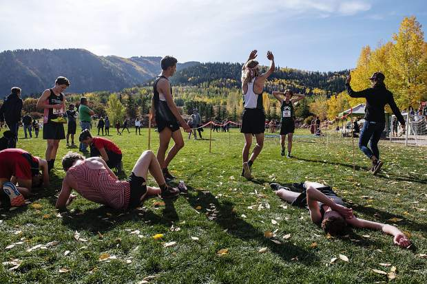 Varsity boys cross country athletes cross the finish line during the 2019 Chris Severy Invitational hosted by Aspen High School on Saturday, October 5, 2019. (Kelsey Brunner/The Aspen Times)