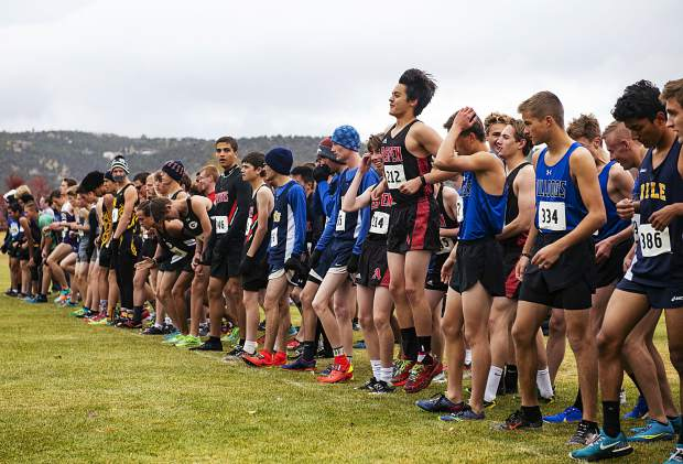 Varsity boys cross country athletes prepare to race in the regional meet at Crown Mountain Park in El Jebel on Friday, October 18, 2019. (Kelsey Brunner/The Aspen Times)