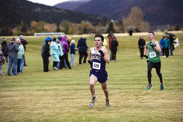 Basalt's Tucker Bruce, left, sprints to the finish line closely followed by Delta's Shad Lewis during regionals at Crown Mountain Park in El Jebel on Friday, October 18, 2019. (Kelsey Brunner/The Aspen Times)