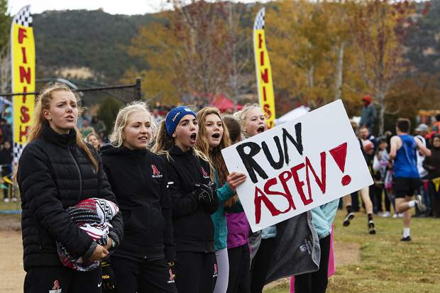 Aspen High School students and cross country athletes cheer for their varsity boys runners during the regional meet at Crown Mountain Park in El Jebel on Friday, October 18, 2019. (Kelsey Brunner/The Aspen Times)