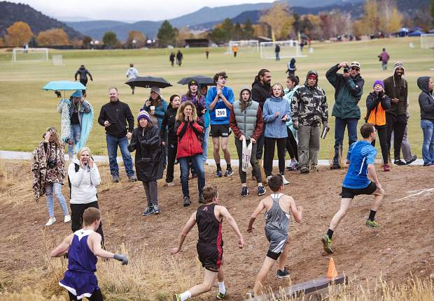 Friends and family of the varsity boys cross country athletes cheer for their runners as they compete in the regional meet at Crown Mountain Park in El Jebel on Friday, October 18, 2019. (Kelsey Brunner/The Aspen Times)