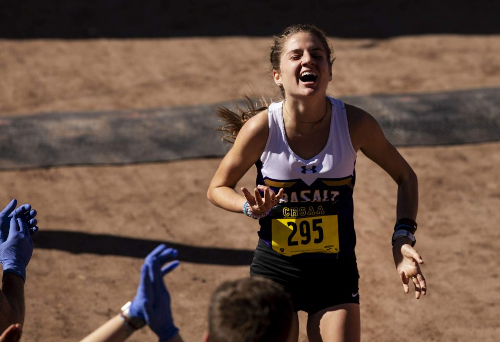 Basalt High School junior Sierra Bower reacts as she crosses the finish line in first place to win the Class 3A girls cross country state championship race with a time of 18:00.1 on Saturday, Oct. 26, 2019, at the Norris Penrose Event Center in Colorado Springs. (Chancey Bush/The Gazette)