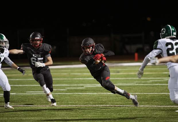 Aspen Skiers Jack Seamans runs the ball during the game against Delta High School on Friday, Oct. 4, 2019. (Kelsey Brunner/The Aspen Times)