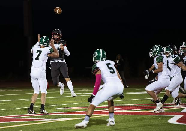 Aspen Skiers quarterback Tyler Ward passes the ball over the heads of the Delta High School team during the game on Friday, Oct. 4, 2019. (Kelsey Brunner/The Aspen Times)