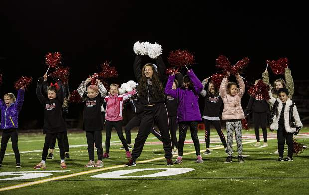 Aspen High School's Spirit Team leads their spirit camp during the halftime show on Friday, October 18, 2019. (Kelsey Brunner/The Aspen Times)